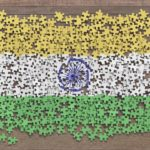 Image of the Indian flag composed of unassembled puzzle pieces